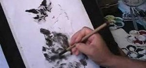 Draw a tabby cat in Chinese brush painting