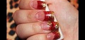 Create red and gold acrylic nails