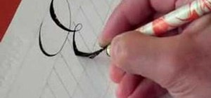 Write the letter E in calligraphy copperplate