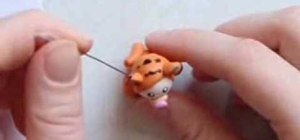 Make a kid wearing a Tigger costume from polymer clay