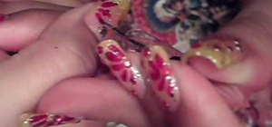 Paint your nails with a red and yellow sparkle design