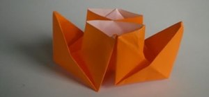 Fold a little paper origami steamer boat