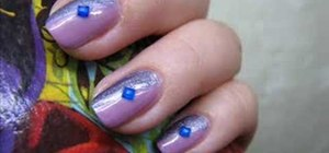 Apply a two-color diagonal manicure with rhinestones
