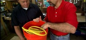 Make a bucket cord caddy to carry extension cords
