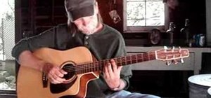 Play an A minor blues progression on acoustic guitar