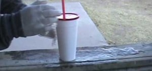 Set up the water balloon and messy cup prank