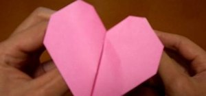 Origami a pink beating heart