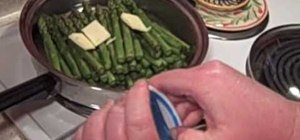 Cook fresh asparagus in a pan
