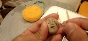 Make a head pendant out of clay