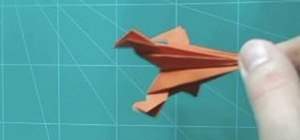 Make a rocket from folded paper with origami