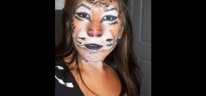 Apply a tiger mask with makeup for Halloween