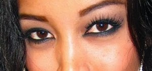 Create femme fatale brown smoky eyes with cat eye liner