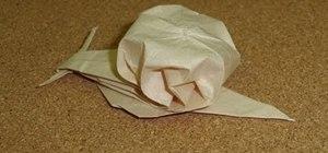 Fold an adorable lifelike origami snail