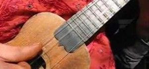 Play the ukulele using a fingerstyle pick