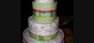 Construct a beautiful flower and bow diaper cake