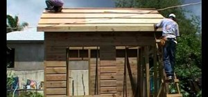 Build a wooden house with a concrete wall that is safe from hurricanes
