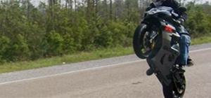 Pop a wheelie on a sport bike