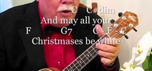 "Play ""White Christmas"" by Irving Berlin on the ukulele"