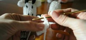 Crochet a cow finger puppet