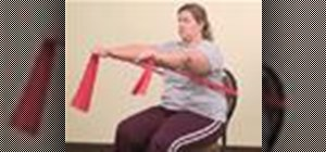 Do a seated chest press exercise with resistance bands