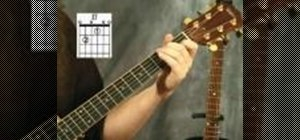 Play the E7 chord on the acoustic guitar