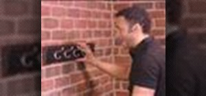 Hang a coat rack on a brick wall