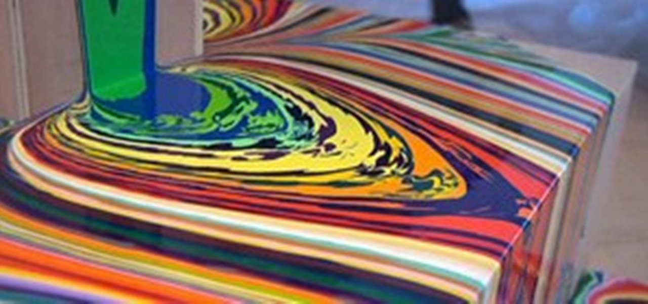 Paint Poured From Glass To Canvas