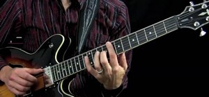 Play a Chicago Blues style twelve bar blues on the guitar with finger picking