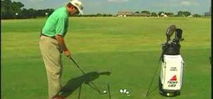 Use two golf clubs to aim and align your shot
