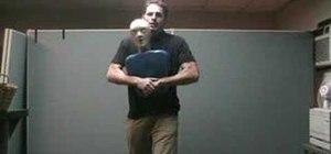 Perform first aid Heimlich maneuver on choking adult