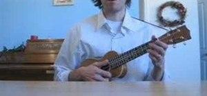 Play clawhammer style on the ukulele