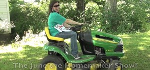 Use a riding lawnmower to mow a large yard or lawn