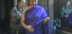 Put on a traditional sari