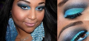 Create a bold turquoise and black eye makeup look