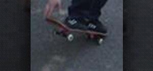 Perform an ollie on a street skateboard