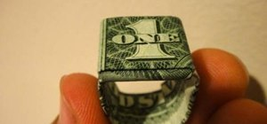 Craft an origami ring out of a one dollar bill