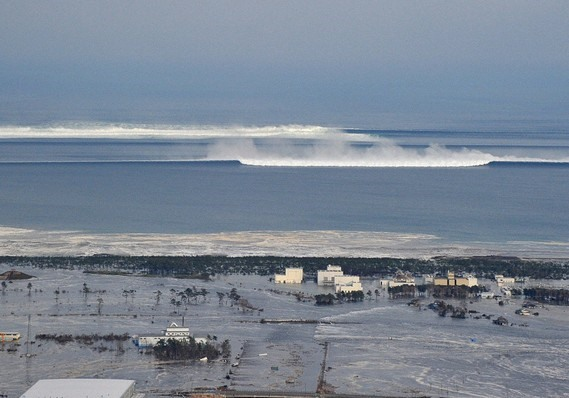 The oncoming tsunami strikes the coast in Natori City, Miyagi Prefecture, nort
