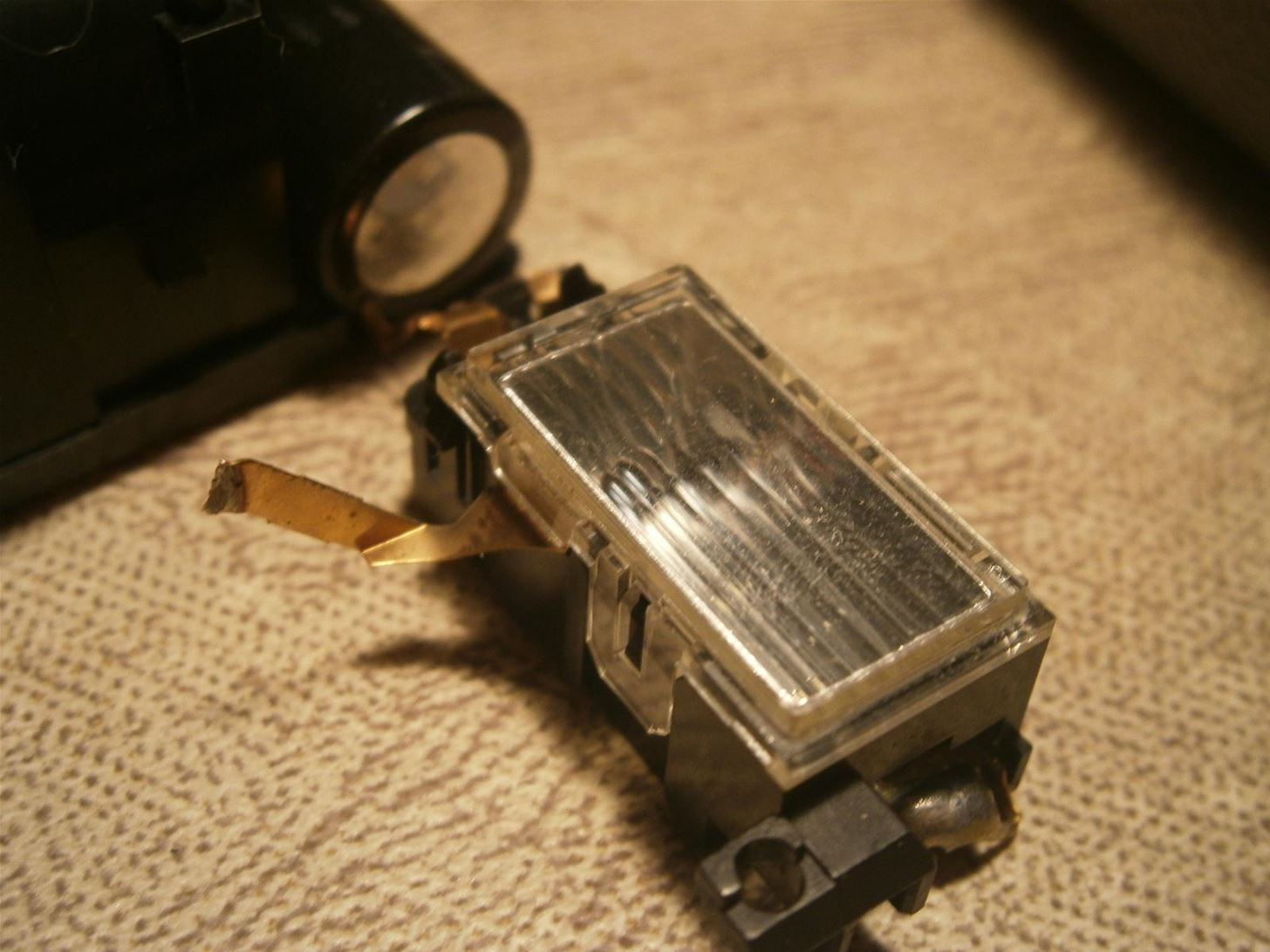 Weapons for the Urban Guerrilla: Make a Taser from a Disposable Camera