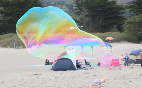 Giant Beach Bubbles Resemble Ghostly Whales