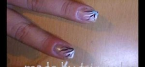 Paint blue & white corner flames on your nails