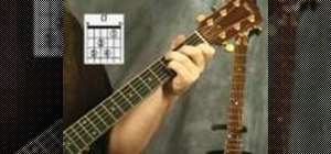 Play the C7 chord on the acoustic guitar
