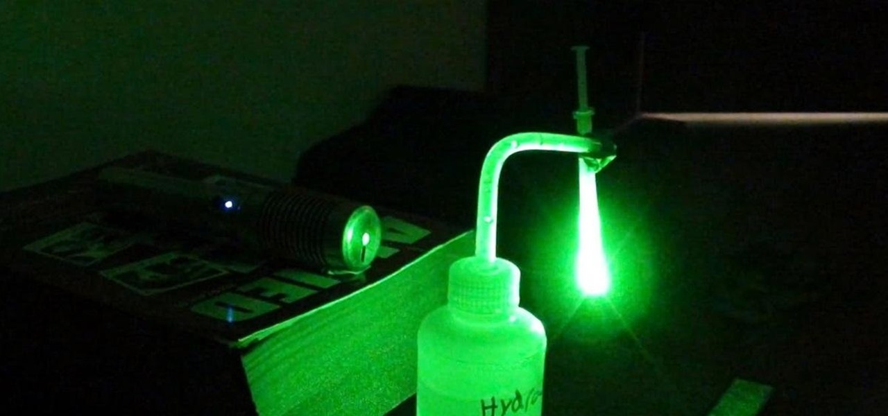 Build Your Own Projection Microscope with a Syringe, Laser Pointer, and Drop of Water