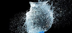 Take a picture of an exploding water balloon