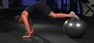 Do medicine ball knee tucks