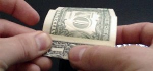 Fold a very simple origami cube from a dollar bill