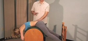 Align your spine with a ladder barrel in Pilates