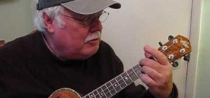 "Play ""Jingle Bell Rock"" by Bobby Helms on the ukulele"