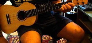 "Play ""Sunday Bloody Sunday"" by U2 on a baritone ukulele"