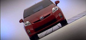 Operate the headlamps on a 2010 Prius