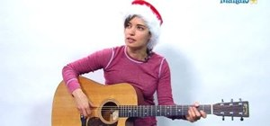 "Play the ""Frosty the Snowman"" Christmas song on guitar"